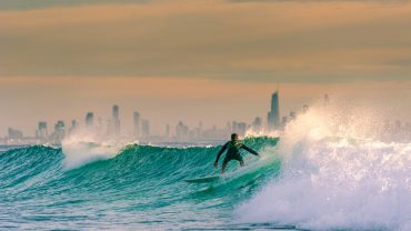 A morning surf on the gold coast. Sunrise near snapper rocks with Surfers Paradise in the background