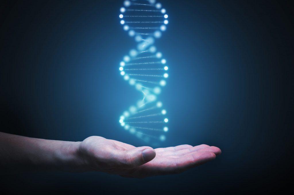 """Hand die glühende DNA hält als Metapher für """"Wie Banken zu Technologieunternehmen transformieren"""""""